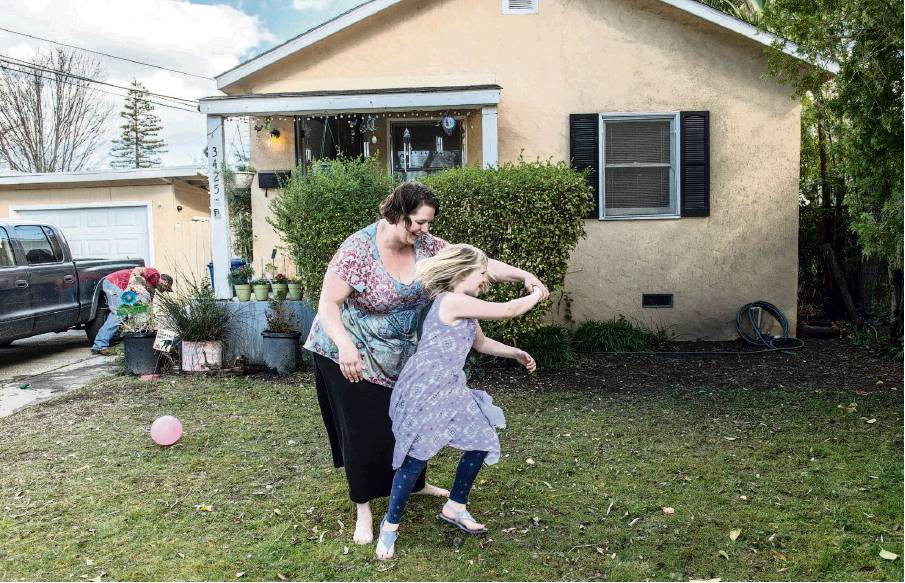 RenÉe C Byer Rbyer Sacbee Jenna Leclerc 30 And Her Daughter Elizabeth 8 Play In Front Of Their Home The Tahoe Park Neighborhood Sacramento